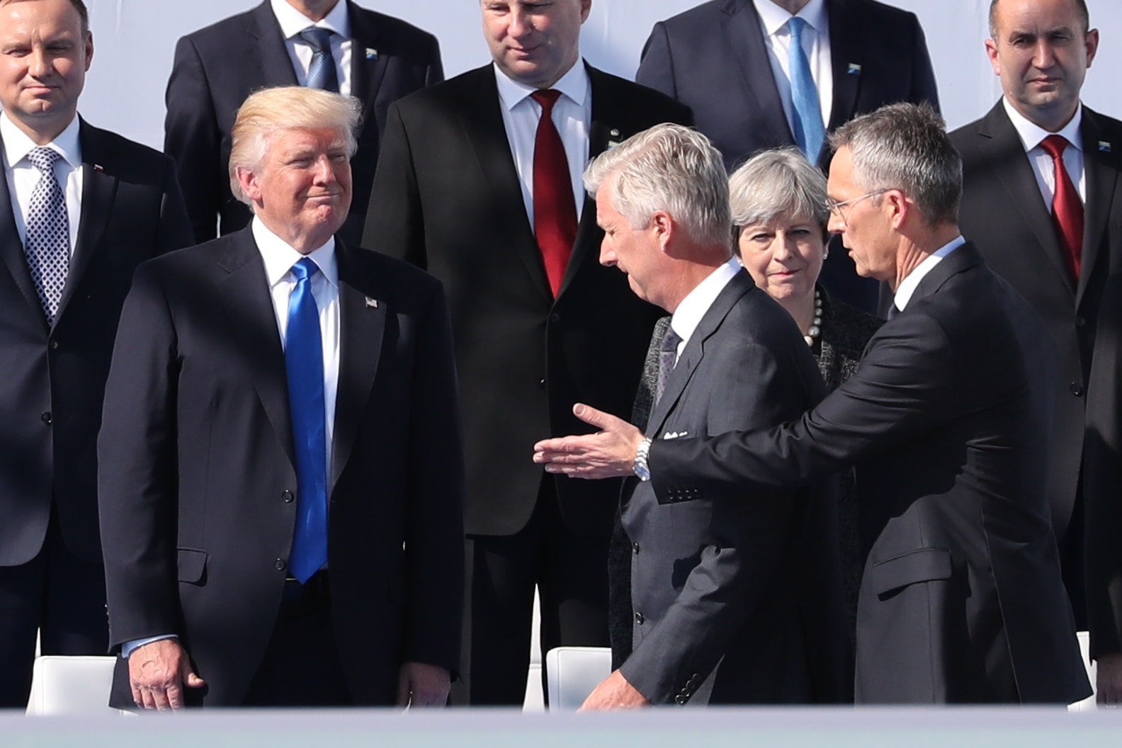 US President Donald Trump, King Philippe - Filip of Belgium, Prime Minister of the United Kingdom Theresa May and NATO Secretary General Jens Stoltenberg pictured during the unveiling ceremony of the new headquarters of NATO, North Atlantic Treaty Organization, in Evere, Brussels, Thursday 25 May 2017.  BELGA PHOTO BENOIT DOPPAGNE