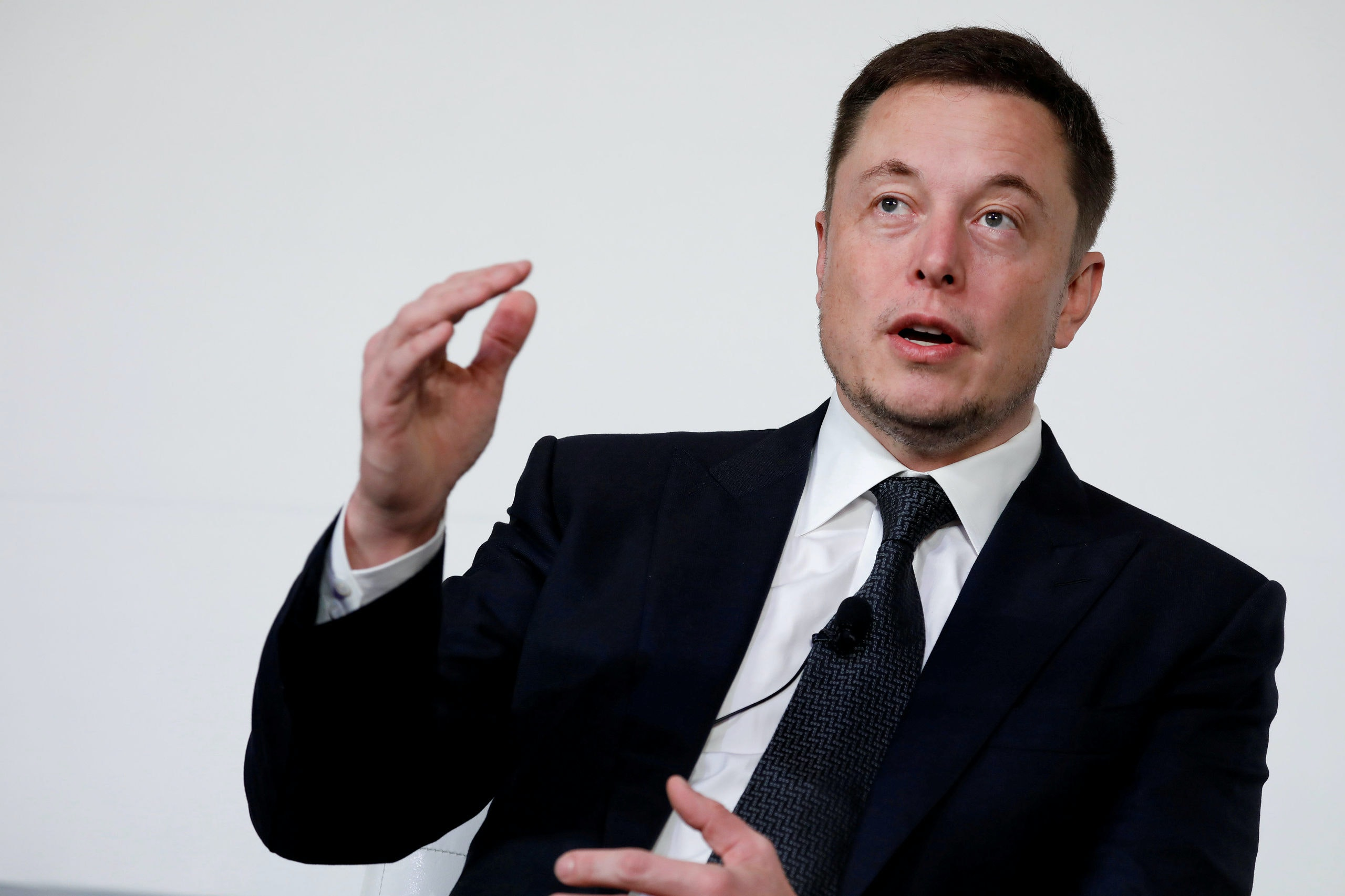FILE PHOTO: Elon Musk, founder, CEO and lead designer at SpaceX and co-founder of Tesla, speaks at the International Space Station Research and Development Conference in Washington, U.S., July 19, 2017. REUTERS/Aaron P. Bernstein/File Photo