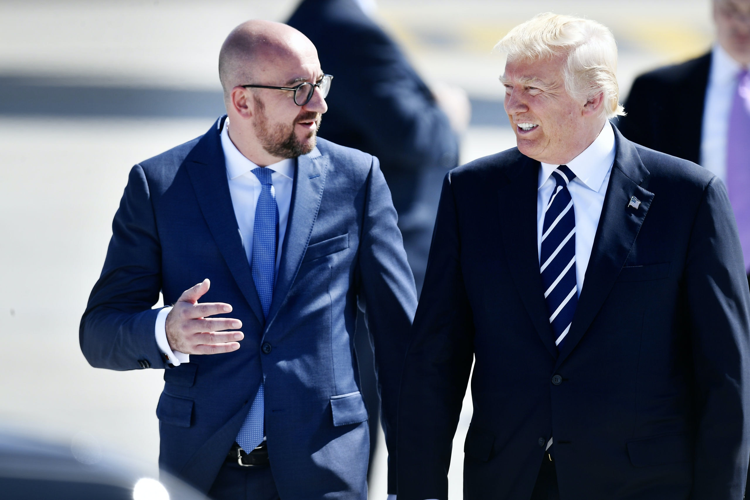 US President Donald Trump and Belgian Prime Minister Charles Michel pictured at the arrival of the President of The United States of America at the military airport in Melsbroek, Steenokkerzeel, Wednesday 24 May 2017. President Trump is on a two day visit to Belgium, to attend a NATO (North Atlantic Treaty Organization) summit on Thursday. BELGA PHOTO ERIC LALMAND