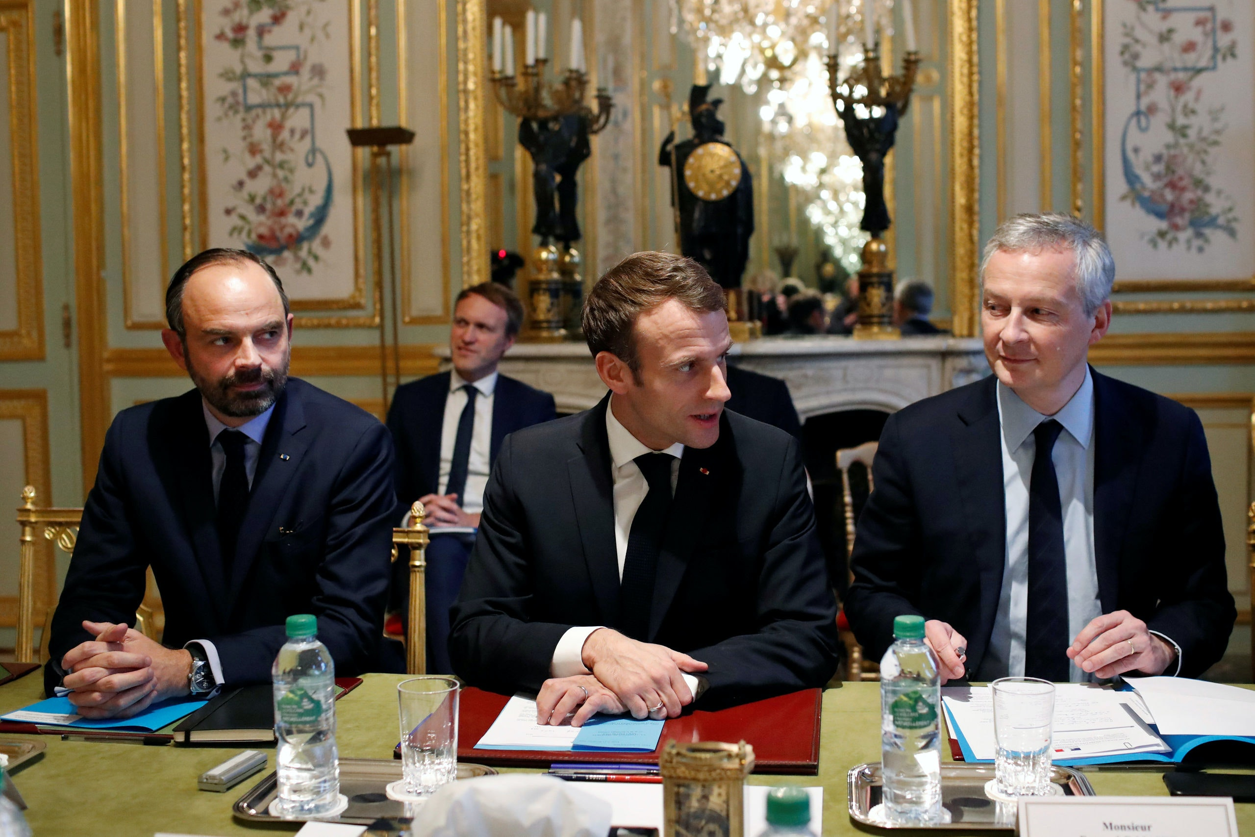 France's President Emmanuel Macron, France's Prime Minister Edouard Philippe and France's Finance Minister Bruno Le Maire attend a meeting with the representatives of the banking sector at the Elysee Palace in Paris, France, December 11, 2018. Thibault Camus/Pool via REUTERS