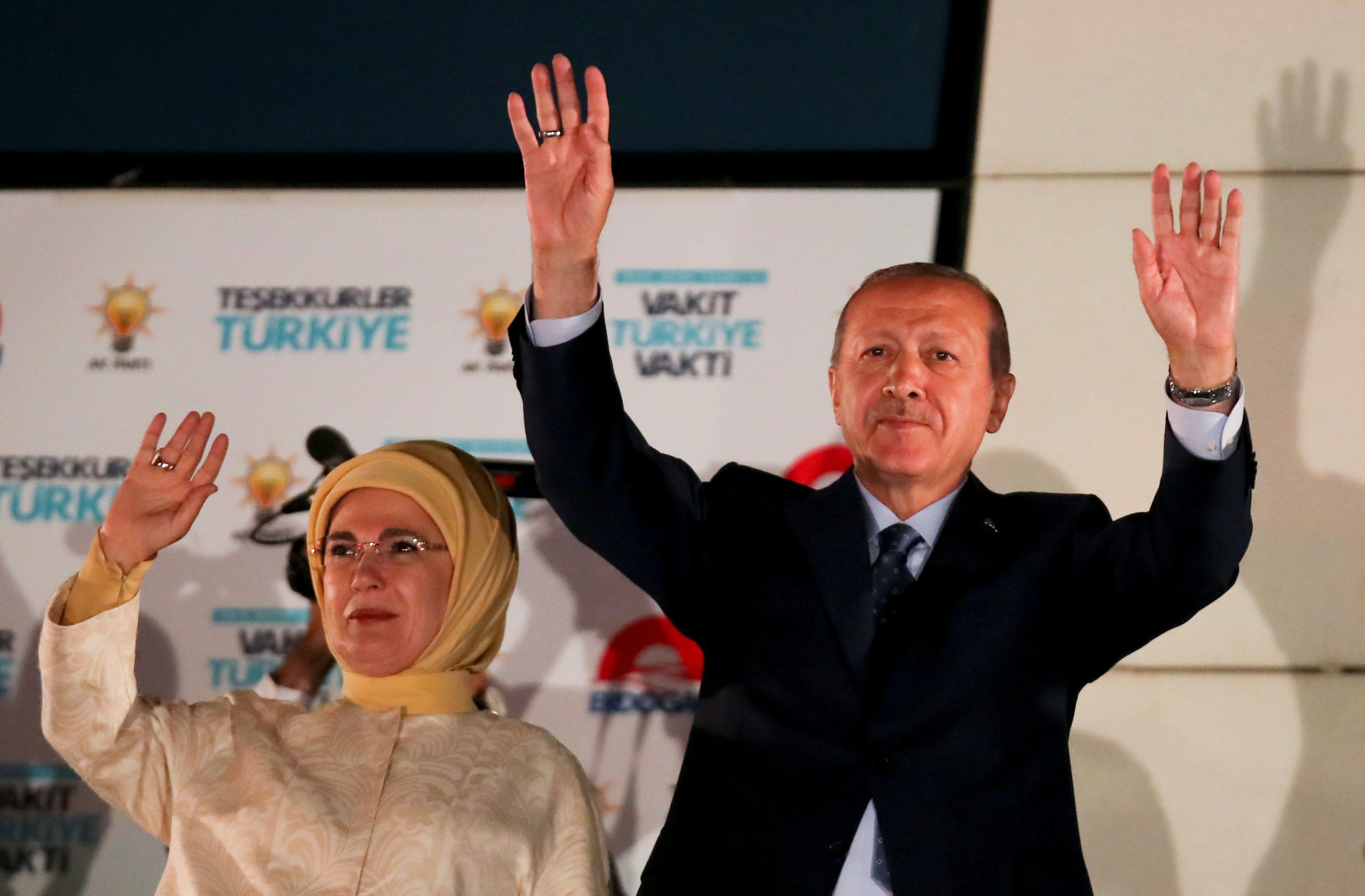 Turkish President Tayyip Erdogan and his wife Emine Erdogan greet supporters gathered in front of the AKP headquarters in Ankara, Turkey June 25, 2018. REUTERS/Umit Bektas     TPX IMAGES OF THE DAY
