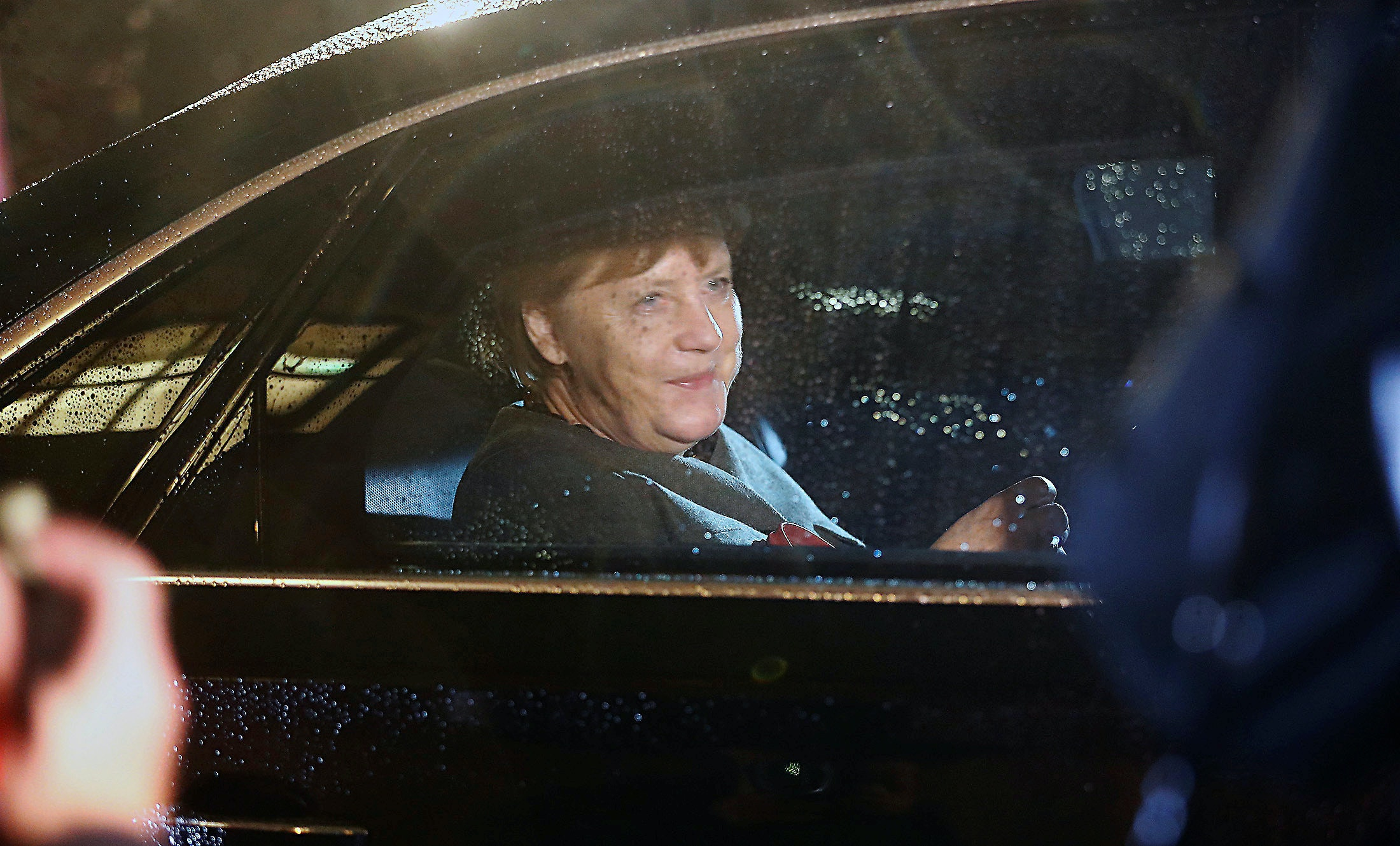 German Chancellor Angela Merkel of the Christian Democratic Union (CDU) leaves the German Parliamentary Society after exploratory talks about forming a new coalition government in Berlin, Germany, November 17, 2017. REUTERS/Hannibal Hanschke