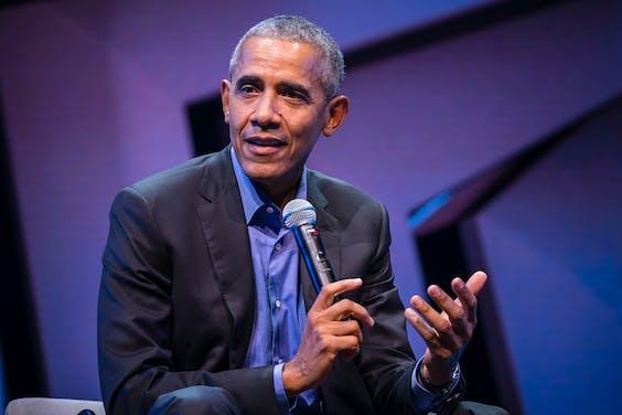 Barack Obama vrijdagavond in Amsterdam bij het Forward Leadership Seminar.