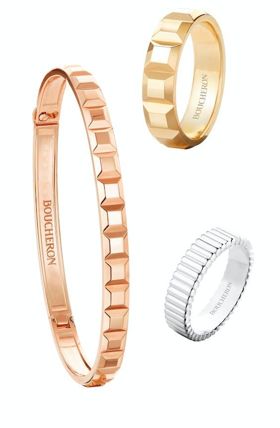 Geelgouden ring en roségouden armband uit Boucherons Quatre Clou de Paris-collectie, witgouden ring uit de Bague Quatre Grosgrain-collectie.