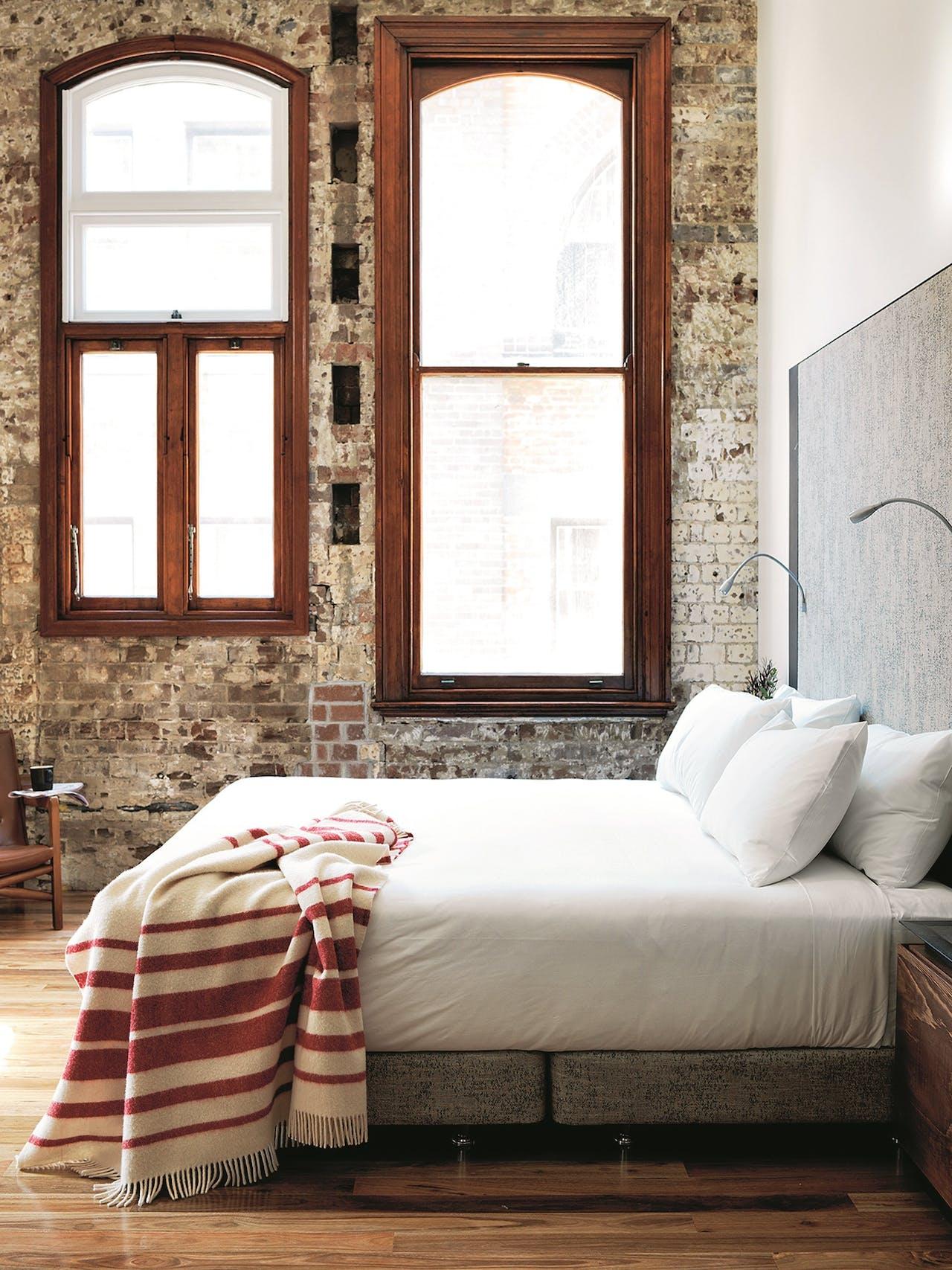 De ruime kamers en suites hebben nog de sfeer van de oude brouwerij.