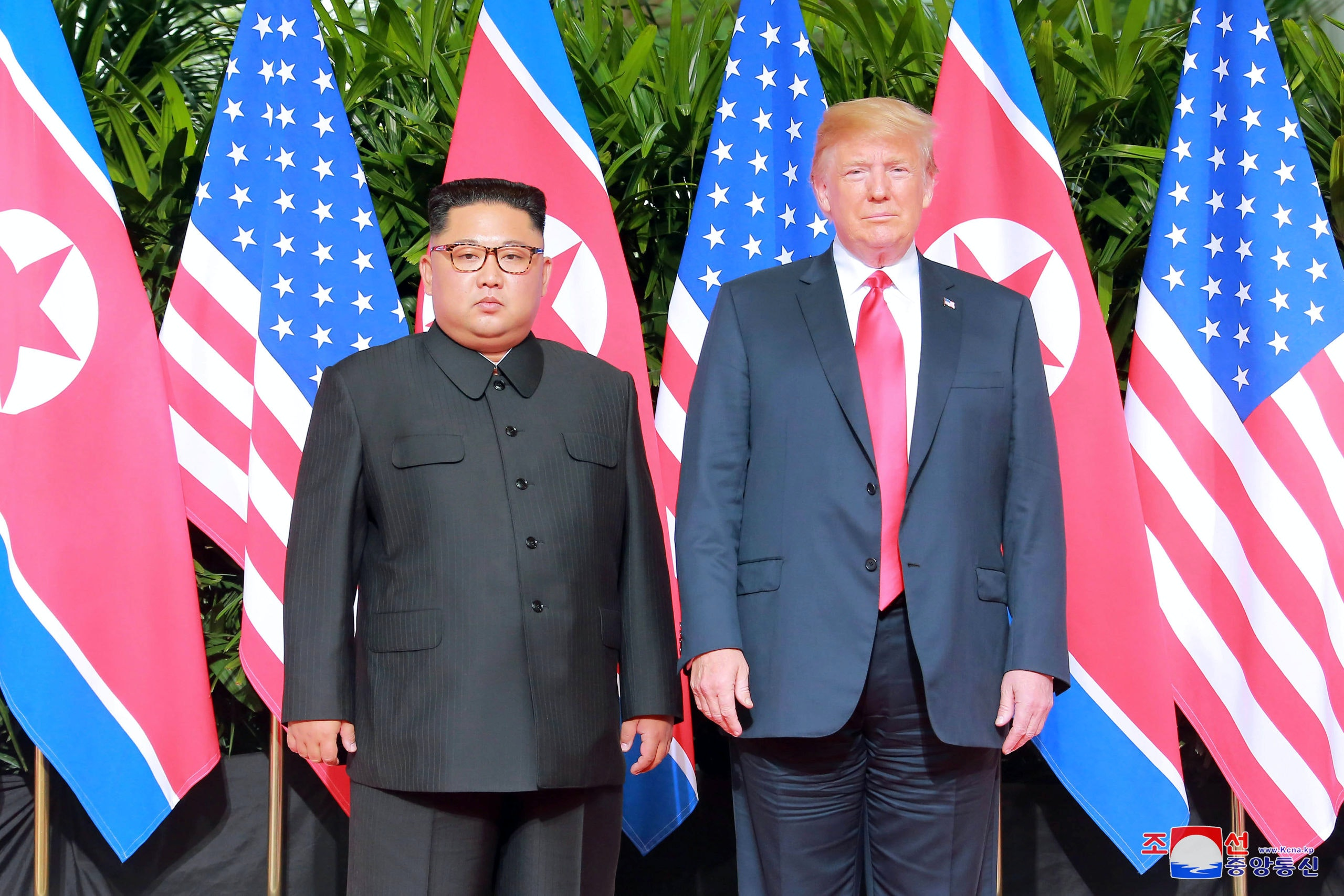U.S. President Donald Trump and North Korean leader Kim Jong Un pose at the Capella Hotel on Sentosa island in Singapore in this picture released on June 12, 2018 by North Korea's Korean Central News Agency. KCNA via REUTERS ATTENTION EDITORS - THIS PICTURE WAS PROVIDED BY A THIRD PARTY. REUTERS IS UNABLE TO INDEPENDENTLY VERIFY THE AUTHENTICITY, CONTENT, LOCATION OR DATE OF THIS IMAGE. NO THIRD PARTY SALES. NOT FOR USE BY REUTERS THIRD PARTY DISTRIBUTORS. SOUTH KOREA OUT. NO COMMERCIAL OR EDITORIAL SALES IN SOUTH KOREA. - RC16222D6E80