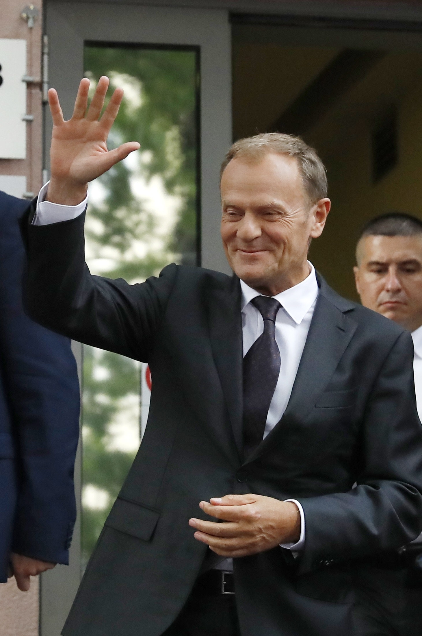President of the European Council Donald Tusk waves as he leaves prosecutor's office in Warsaw, Poland August 3, 2017. REUTERS/Kacper Pempel