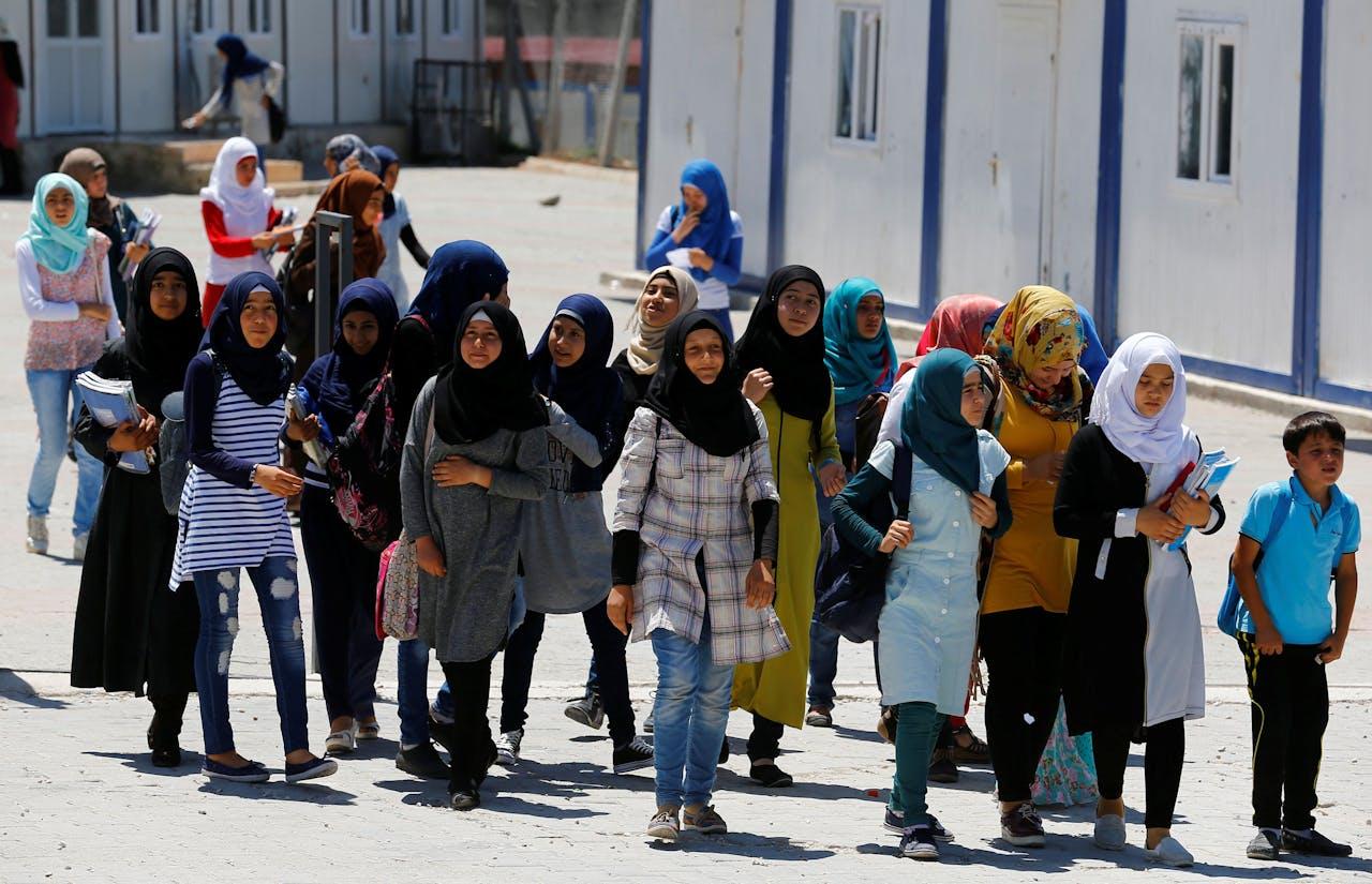Syrische schoolkinderen in een vluchtelingenkamp bij de Turkse stad Osmaniye.