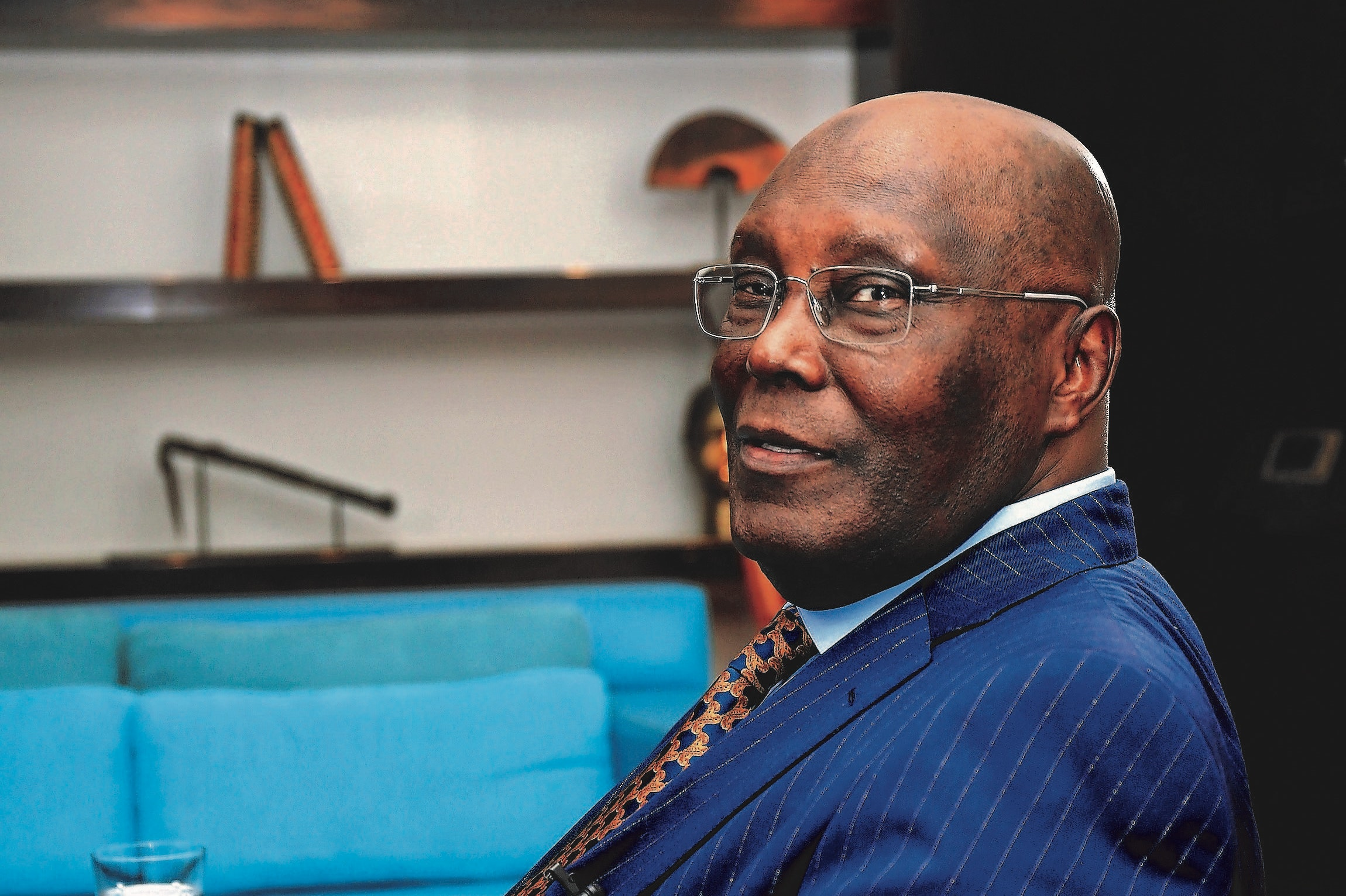 """Atiku Abubakar, Nigeria's main opposition presidential candidate, poses for a photograph ahead of a Bloomberg Television interview in Lagos, Nigeria, on Wednesday, Jan. 16, 2018. Abubakar said he'll sell the state oil company, which he called a """"mafia organization,"""" and attract private investors to drive growth and create jobs if he wins office next month. Photographer: George Osodi/Bloomberg"""