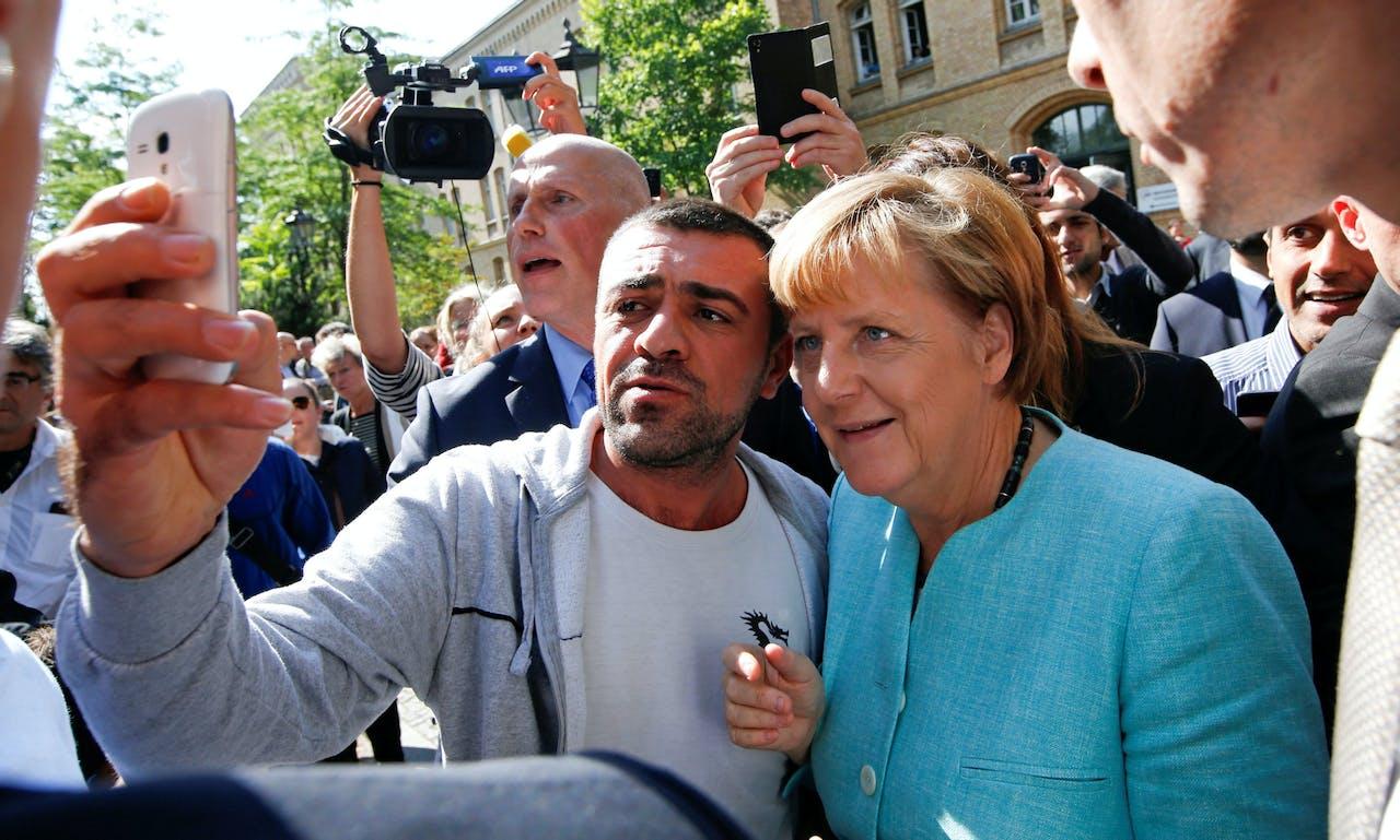 Angela Merkel bezocht tijdens haar verkiezingscampagne deze maand ook vluchtelingen in de Berlijnse wijk Spandau.