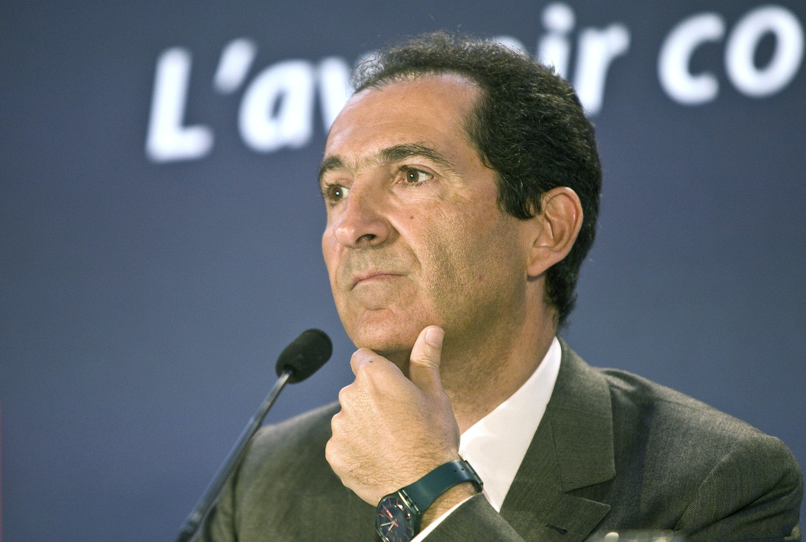 Patrick Drahi, billionaire and chairman of Altice SA, pauses during a news conference in Paris, France, on Monday, April 7, 2014. Billionaire Patrick Drahi's Altice SA won the bidding contest for Vivendi SA's French phone unit SFR, beating a government-backed offer from Bouygues SA by agreeing to a deal valued at more than 17 billion euros ($23 billion). Photographer: Ivan Guilbert/Bloomberg *** Local Caption *** Patrick Drahi